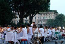 Cena in Bianco, Milano / Un successone: non può essere definita altrimenti la serata del 2 luglio della Cena in Bianco di Milano. Una cena total white che radunava i cittadini (e non) del capoluogo lombardo per condividere insieme un pasto.