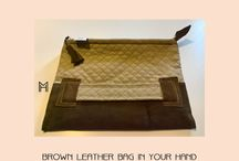 Brown leather bag in your hand