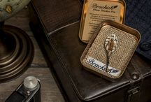 Accessories / We offer cufflinks, handkerchiefs, pocket squares, and socks in fabrics that include cotton, wool, cashmere, and silk. Further, we offer other a beautiful selection of shoes, neck wear and exclusive belts in Italian leather and other exotic skins such as crocodile, alligator, lizard and ostrich.