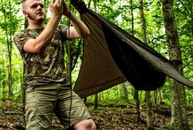 Shelter Building / Maintaining core body temperature is of primary importance in a survival situation.  Your first shelter is your clothing and beyond that can be achieved with tarps, similar or natural materials.