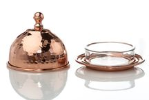 Element Copper Line / Our new Element Copper Line of high quality hammered and smooth pieces, some featuring brass accents. Copper's warmth and reflective qualities add a special dimension to any table setting at any time of the year.