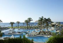Prime Beach-front Location / Set in an idyllic setting on a beautiful seashore, the luxury Rodos Palladium Leisure & Wellness stretches right in the middle of the blue flag awarded beach of Kallithea and next to the picturesque monument of Kallithea Springs