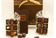 Say it with chocolate... / Immerse yourself in the heavenly world of our exquisite Belgian chocolate.  Beautifully hand selected, our tissue wrapped chocolates are presented in luxury boxes, tied with a single elegant ribbon.   Whatever you are looking to say this year... say it with Belgium's finest chocolates.