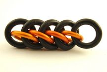 Chain maille - with Rubber / Or neoprene or other stretchy materials.  / by Shawna Jones