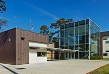 John Cooper School / The John Cooper School is meant to inspire learning through a challenging curriculum in a caring environment. Using zinc for the facade reflects these ambitions, as it is compatible in interacting with most other building materials and is aesthetically pleasing because it comes in a variety of colors to use. In this case, PIGMENTO red and ANTHRA-ZINC (a rich, charcoal black) blend naturally with the surrounding wood and glass to provide a clean, smooth and fresh outer appearance.