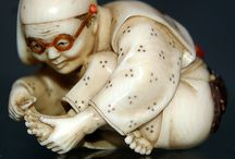 NETSUKES, INRO AND OTHER JAPANESE CARVINGS / Tagua nuts and other netsuke. / by Ronni Rittenhouse