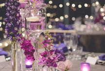Purple + Platinum Wedding / With fairy light walls, the light from this wedding illuminated an assortment of purple florals on exquisite silver pintuck tablecloths. Silver charger plates, ornate napkin rings and purple frosted tealights were accentuated by custom designed stationery. Menus, table numbers and place cards were adorned with a custom purple wax seal. The intimate and romantic style our couple strived for was finished with Limewash Tiffany chairs dressed in crushed taffeta sashes.    www.enchantedempire.com.au