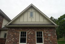 Navajo Beige in Olivette MO. (63132) / This is a siding remodel job located in Olivette Missouri. It features James Hardie Board & Batten Siding in Navajo Beige and James Hardie Lap Siding in Sail Cloth.