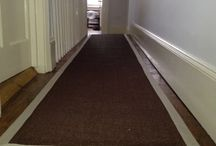 Stairs & Landings With A Grey Border / Client: Private Residence in East London Brief: To do a brown-coloured carpet runner with distinct edgings for a neat finish.