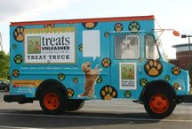 tu treat truck / This brightly decorated, pet-focused truck brings smiles to all the pets and their people who see it. The Treat Truck team provides a unique experience for its customers while delivering its famous treats with the same high level of customer care that they receive in the Treats Unleashed shops.