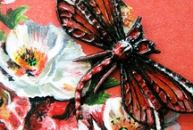 Hand Painted Red Dragonfly Necklace & Gift Box Painted With Poppies / I made this vintage style, dragonfly necklace that I hand painted in red, black and white. The colors range from true red to shades of a lighter orange red. I also painted the body of the dragonfly with black and white details based on a real dragonflies markings. I carefully and painstakingly painted this dragonfly pendent and directly onto the metal with love.  The red dragonfly necklace comes with a jewelry box that I painted with vintage poppies onto the lid.  / by Painted Fancy