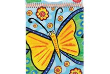 """imagination sketchbooks / An imagination sketchbook is the ultimate sketchbook to take any where you can imagine! Bring along doodle stick markers and imagination sticks for endless creative fun.  This 9"""" x 12"""" sketchpad includes 30 sheets of paper, colorful plastic spiral binding with heavy board handle and 3 bonus sticker pages (100 stickers), including stickers for kids to color and make uniquely their own!"""