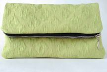 Poetry Clutches / Beautiful fold-over clutches with a custom zipper and poem/quote stitched inside.