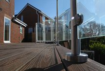Trex Transcend Residential Project - New Heights / 45 square metres of Trex Transcend  composite decking in Lava Rock finish, accessed by double doors from the lounge creates a striking leisure area linked to the garden with bespoke Trex steps.  Designed, supplied and installed by Whalley Construction, the Trex composite deck features a stunning glass and 316 grade stainless steel balustrade which provides a contemporary contrast to the traditional appearance of the decking.