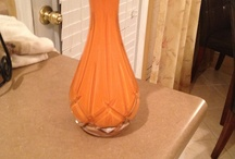 DIY accessories  / I bought a sample of paint from Lowes and poured it in the clear vase and swirled it to cover the vase from the inside and let it dry and viola you have your accent color showing through your vase. Did this for a client who had a very tight budget.  / by Modern Age Designs, LLC