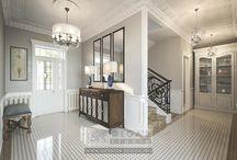 Дизайн холла с лестницей в доме / Дизайн холла в частном доме отвечает современным представлениям о практичных стильных интерьерах. Светлые оттенки, натуральные материалы, симметрия в расстановке предметов, высокие белые двери с фрамугой, модерновые завитки в декоре лестницы — все эти характеристики рассматриваемого дизайн-проекта формируют его индивидуальность.