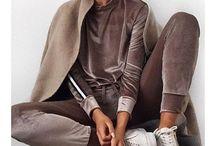 velour jumpsuit i grå med en stribe ved armet