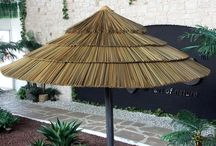 Synthetic Thatch Umbrellas / Synthetic thatch umbrellas are a beautiful canvas alternative that provides a tropical atmosphere paired with shade and comfort. Guaranteed to last for 15 years, synthetic thatch umbrellas are ideal for many weather conditions. These umbrellas come in two panel style options - A synthetic Reed Thatch or a synthetic Palm Thatch.