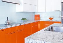 Orange High Gloss Kitchens / Orange High Gloss, Modern Kitchens with Premier Eurocase's Reflekt panels.