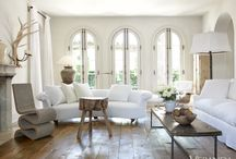 Pamela Pierce Designs / Interior design by MILIEU editor Pamela Pierce (French, Swedish, Belgian, European, Gustavian, Scandinavian antiques, modern art, minimal, feminine, romantic, timeless, tranquil, farmhouse, elegant, traditional decor with reclaimed stone, biots, white roses, linen, slipcovers, ruffles, skirted tables, Lefroy Brooks, cremone bolts, steel windows and doors, rustic wood, white, neutrals, country, Chateau Domingue, oversize sconces, and chandeliers.