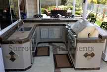 Outdoor living / An Outdoor Kitchen (differing from the Barbecue Island) is normally a self-contained, built-in unit (or gives the impression of being built-in). We can build your outdoor kitchen complete with barbecue, side burner, sink, refrigerator, kegerator, bar center, storage areas, stereo system and under counter lights.