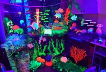 coral reef and fish in blacklight