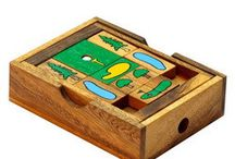 Sliding Block Puzzles / Traditional Sliding Block puzzles.  http://shop.siammandalay.com/collections/sliding-block-puzzle