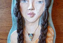 clay relief faces
