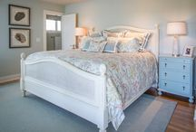 STYLE:  transitional/coastal / A little bit of snappy, a little bit of casual and a whole lot of comfort.  Blues and spa colors help define this style. Lots of whites, lots of seashells and fish and anything from the sea.