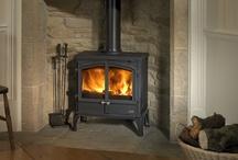 Wood burning stove/stone fireplace