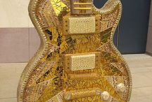 Musical Instruments  / Guitars and other stringed instruments that are unusual  / by William Kissinger