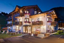 """Hotel Garni Costanza Livigno / We are directly located on the slopes, very close to the new cableway \""""Cassana\"""", and while wearing your skis you can give vent to your zest for snow, fill up your energy and spend fantastic days on the COSTACCIA-CAROSELLO 3000 in Livigno. You can easily reach the SKI AREA MOTTOLINO on the opposite side with the shuttle-service, which in addition brings you free of charge to any destination in Livigno!"""