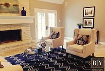 BY Design Living Areas / Cozy up in our staged living rooms.