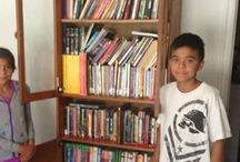 A boy who asks mailman for junk mail to read / This boy couldn't afford to buy books