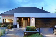 HomeKONCEPT 31 | Projekt domu / HomeKONCEPT-31 jest pomniejszonym wariantem naszego urzekającego domu parterowego HomeKONCEPT-26. Szczególną uwagę zwraca przestronny taras i szykowna elewacja domu skomponowana poprzez połączenie płyt betonowych z wysokogatunkowym drewnem oraz zastosowanym białym belkowaniem wokół domu. Nie sposób jest przejść obojętnie obok okazałego wejścia frontowego, subtelnie skrytego pod drewnianym belkowaniem.