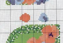 gráficos  de ponto cruz bem variados.