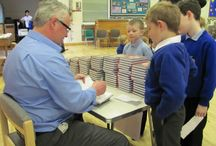 """Harefield Junior School UB9 6BJ / Free school visit to Harefield Junior School UB9 6BJ. Photos show a typical visit with 'laugh while you learn' slideshow presentation, then questions and answers, followed by a """"Meet the Author' book-signing session."""