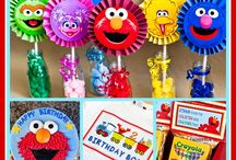 Elmo/Sesame Street Themed Party / Sesame Street / Elmo Themed Birthday Party including tons of DIY decorations and festive party flare!  Free printables, Food table tent cards, character posters for Cookie Monster, Elmo, Bert & Ernie, Grover, Oscar, Big Bird, and many more!  Come check out Melly Moments Blog for party planning ideas that will save you time, money, and energy.  Kids will love the colorful party favors/goody bags.