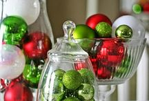christmas decorations in a glass vase