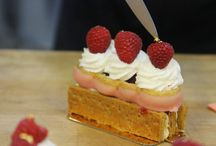 MilleFeuille / MilleFeuille, French for a thousand leaves, received its special name because of the similarity of fine flaky leaves to delicate puff pastry when stacked and layered in dessert form.