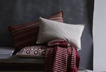 Cushions & Throws / Made up of smooth cottons, linens and wool in subtle shades of palest grey, deep indigo, soft red and zingy chartreuse the Murmur cushion and throw collections can be layered beautifully in a mixture of scale, texture and colour to create a comfortable place to relax.