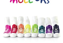 Mocc Ons ( Moccasin style slipper socks ) / Mocc Ons Marching off the Shelves!  Mocc Ons are moccasin style slipper socks, designed to fit baby from six months up to three years. They're made of a lovely soft and stretchy cotton, stitched to a real leather sole, which helps to prevent slipping ensuring that your little one's toes stay toast toasty all year round! Mocc Ons are available in four funky designs and now NEW Sneaker style for style conscious parents looking for an easy way to to keep little feet snuggly.