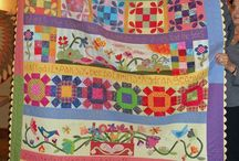 QUILTS Row By Row