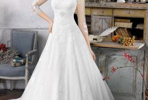 wedding dresses / by April De Jong