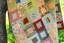 Snuggle up in a Quilt / by Laura Lizcano
