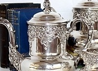 Silver teapots galore / Pouring tea from those gorgeous pots glistening in SILVER..... / by Karen Lewis