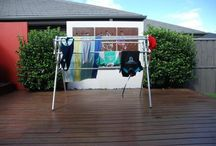 Flexi -  Portable clothes airer clothes line drying rack washing line / Flexible by name and flexible by design. This clothes airer easily caters for 1 load of washing with room spare. The drying rack includes loops. These loops are great for hanging socks and provide a perfect place for coat hangers. When turned over, the loops become hooks, which are just the thing for smalls. As with all Hanging Stuff products, the Flexi is lightweight, a very portable clothes airer with or without washing and can be folded when not in use.