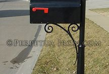 black iron mailboxes and post