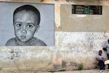 Del lienzo al muro: Artistas cubanos dan vidaa las calles de La Habana