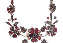Royal Red / A variety of red garnet jewellery pieces featuring in an auction of Vintage Jewellery & Accessories taking place Monday 24th March at 10am